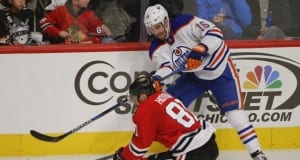 Oilers Teddy Purcell and Marian Hossa of the Chicago Blackhawks