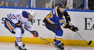 Kevin Shattenkirk of the St. Louis Blues and Benoit Pouliot of the Edmonton Oilers