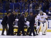 Nashville Predators Kevin Fiala taken off on a stretcher