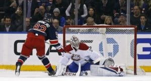 Carey Price of the Montreal Canadiens and Mika ZIbanejad of the New York Rangers