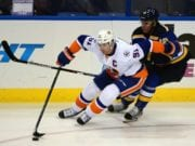 John Tavares of the New York Islanders and Jori Lehtera of the St. Louis Blues