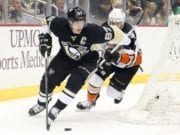 Sidney Crosby of the Pittsburgh Penguins and Andrew Cogliano of the Anaheim Ducks