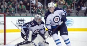 Jacob Trouba and Connor Hellebuyck of the Winnipeg Jets
