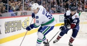 Bo Horvat of the Vancouver Canucks and Patrick Wiercioch of the Colorado Avalanche