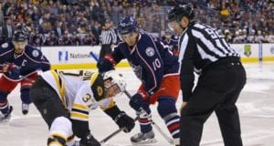 Alexander Wennberg of the Columbus Blue Jackets and Patrice Bergeron of the Boston Bruins