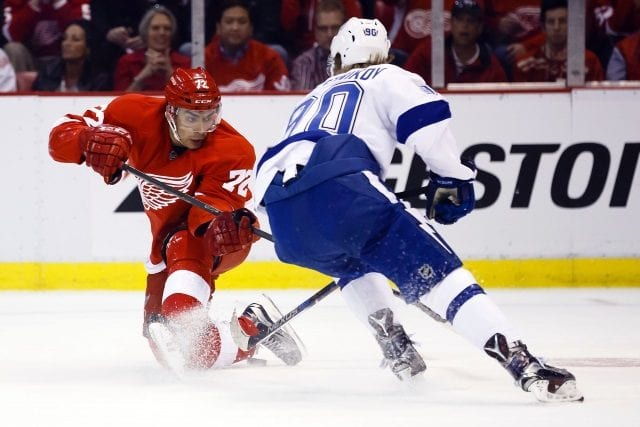 Andreas Athanasiou of the Detroit Red Wings and Vladislav Namestnikov of the Tampa Bay Lightning