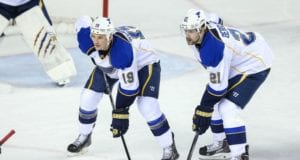 Jay Bouwmeester and Patrik Berglund traveling with the St. Louis Blues, but won't play.